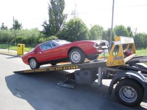 Soccorso stradale a Modena H24. Carroattrezzi con Ferrari Rossa a Modena