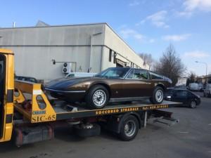 Soccorso stradale a Modena H24. Carroattrezzi con Ferrari marroni caricata